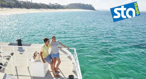 A couple enjoys a whale and dolphin cruise at Nelson Bay, Port Stephens
